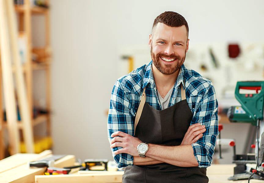 A smiling member of the DIY technical team | DIY Refurb